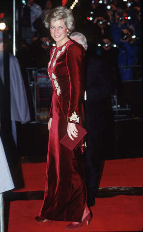 "Princess Diana at the premiere of the film ""Steel Magnolias"" at The Odeon Leicester Square, wearing a burgundy velvet evening dress designed Catherine Walker. Photo: Tim Graham, Tim Graham/Getty Images / Tim Graham Photo Library"