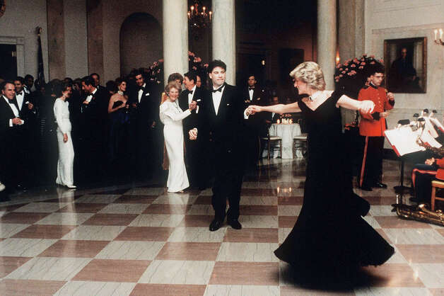 Diana, Princess of Wales dancing with John Travolta at The White House in a midnight blue velvet dress by Victor Edelstein. Photo: Pool/Tim Graham Picture Library, Tim Graham/Getty Images / Tim Graham Photo Library