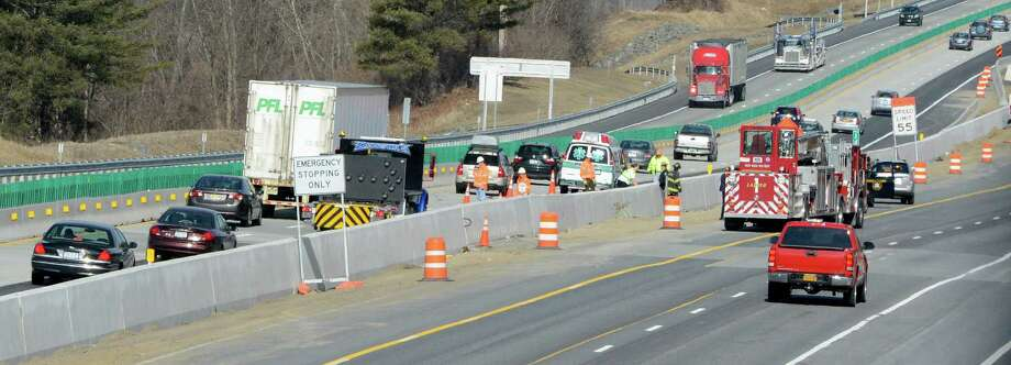 Emergency vehicle is lined up to assist in a an accident on March 15, 2013,  near mile marker 144.5 northbound on the Thruway in Albany, N.Y.     (Skip Dickstein/Times Union) Photo: SKIP DICKSTEIN