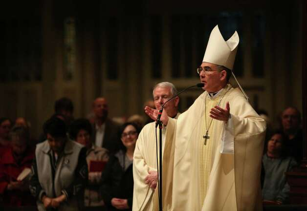 Seattle Archbishop J. Peter Sartain prays during a mass for new Pope, Francis I, on Wednesday, March 13, 2013 at St. James Cathedral in Seattle. Photo: JOSHUA TRUJILLO / SEATTLEPI.COM