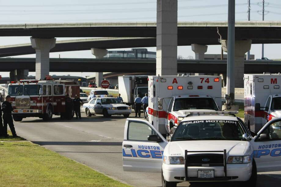 Police investigate a Friday accident in which a motorcyclist fell from a freeway overpass off Interstate 45 near Greenspoint Mall. Photo: Cody Duty/Houston Chronicle