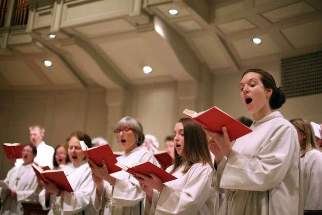 Amy Kilian sings with the choir during a mass for the new Pope, Francis I, on Wednesday, March 13, 2013 at St. James Cathedral in Seattle. Archbishop of Seattle Peter Sartain held a mass for the new pontiff. Photo: JOSHUA TRUJILLO / SEATTLEPI.COM