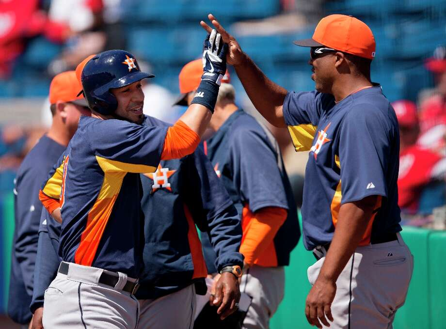 Marwin Gonzalez, left, is congratulated after hitting a home run during the first inning. Photo: Evan Vucci
