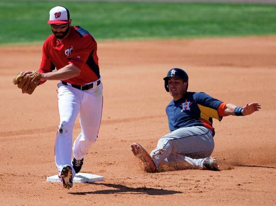Nationals infielder Danny Espinosa, left, steps on second base to force out Jason Castro during the fourth inning. Photo: Evan Vucci