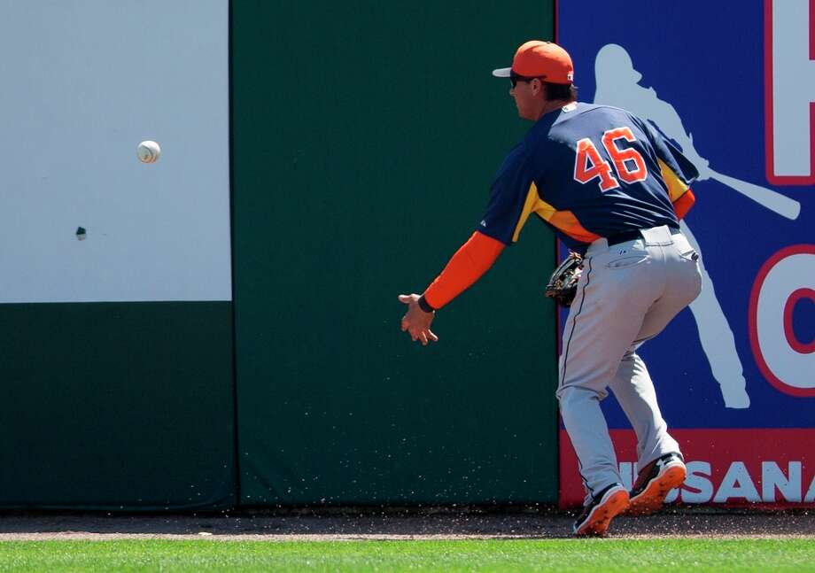Astros outfielder Rick Ankiel loses track of the baseball after it hit the right field wall during the second inning. Photo: Evan Vucci
