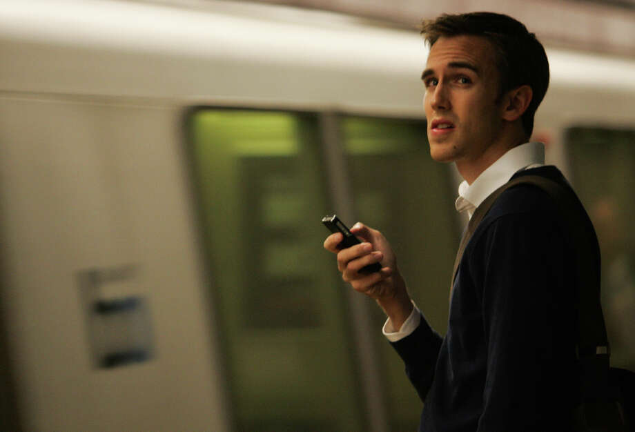 BART rider Benjamin Craven waits for a train at the Montgomery Station during the evening commute to get to Oakland on Thursday, June 14, 2012. His normal 30 minute morning commute into San Francisco turned into two hours when the transbay tube was shut down due to a construction fire. Photo: Mathew Sumner, Special To The Chronicle / ONLINE_YES