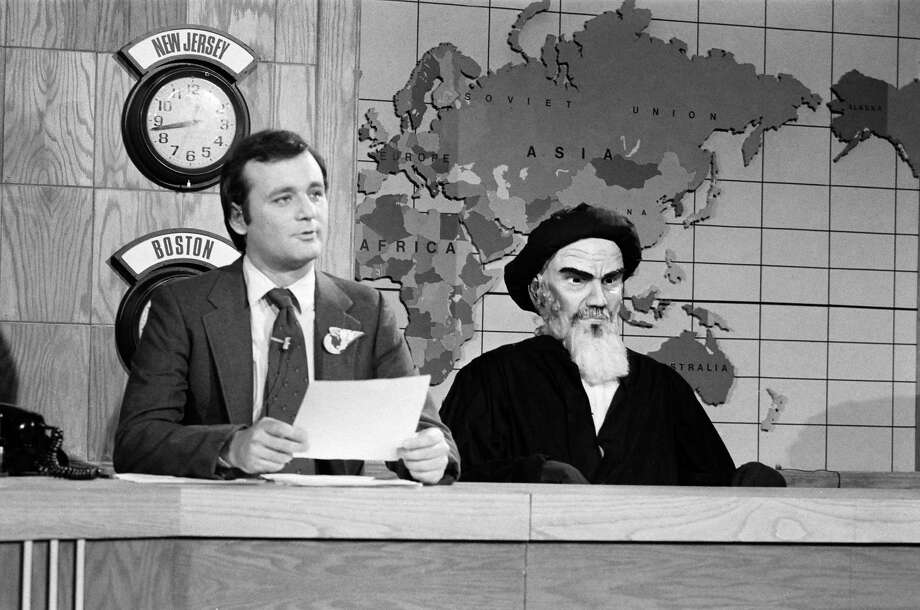 """OK, I really wanted to use a photo of puppet King Jong Il from """"Team America: World Police,"""" but I couldn't get a photo from Paramount. So here's Bill Murray during the Saturday Night Live 'Weekend Update' sketch in 1980 with an Ayatollah Khomeini puppet. Photo: NBC, Getty Images / 2012 NBCUniversal Media, LLC"""