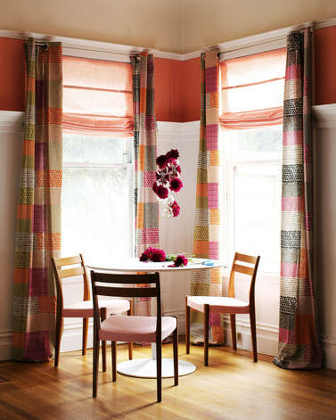 Stencils and bright curtains make this rental apartment pop. Photo: Kyle Schuneman