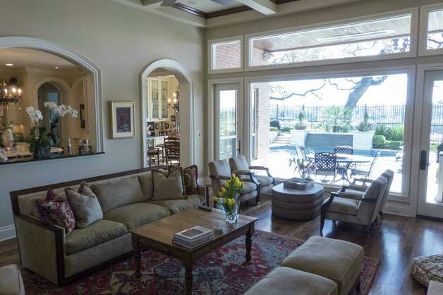 The family room has a view of the swimming pool and golf course.