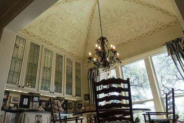 A stenciled ceiling accents the breakfast room.