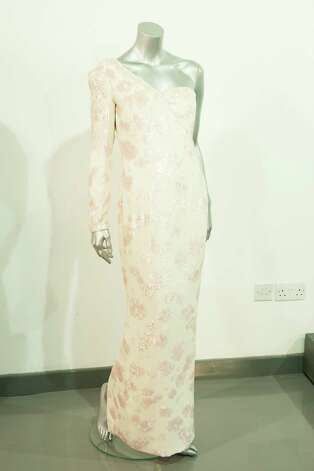 Also up for auction is a Catherine Walker pink sequined ivory crepe gown with asymmetric neckline, worn at the banquet given by President Collor on a state visit to Brazil in 1991. Photo: Simon Burchell, Getty Images / 2013 Getty Images