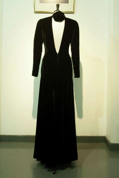 Also up for auction is a Bruce Oldfield black velvet gown worn for a Lord Snowdon Portrait 1985.