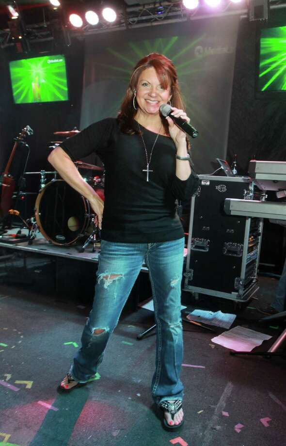 Singer Deborah Michaelsrocks the stage at Mo's Place. Photo: Gary Fountain, For The Chronicle / Copyright 2013 Gary Fountain.