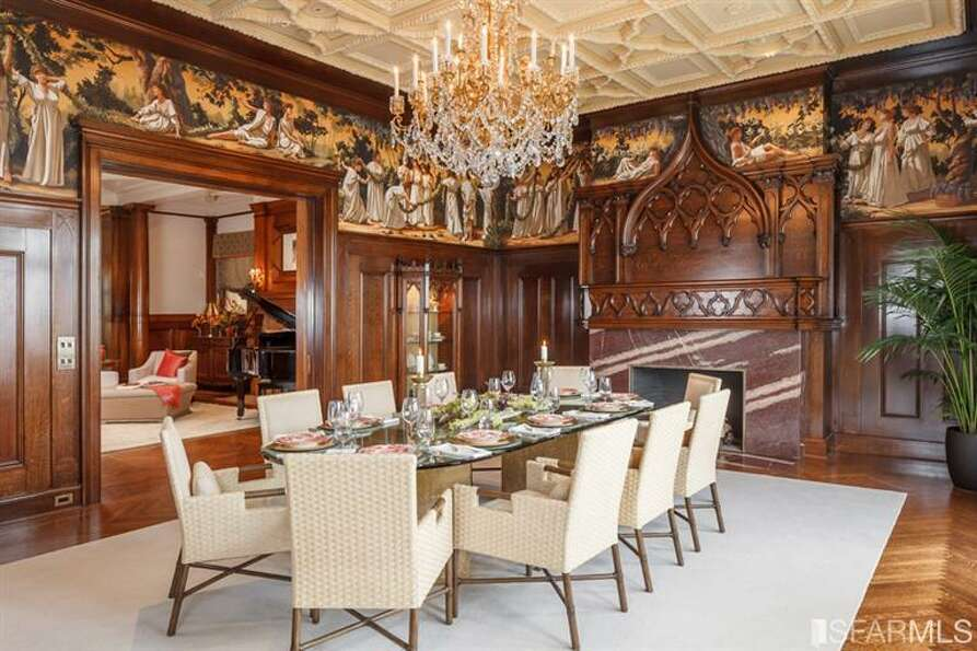 Dining room with built-ins, frescos. All photos via Sotheby's/MLS.