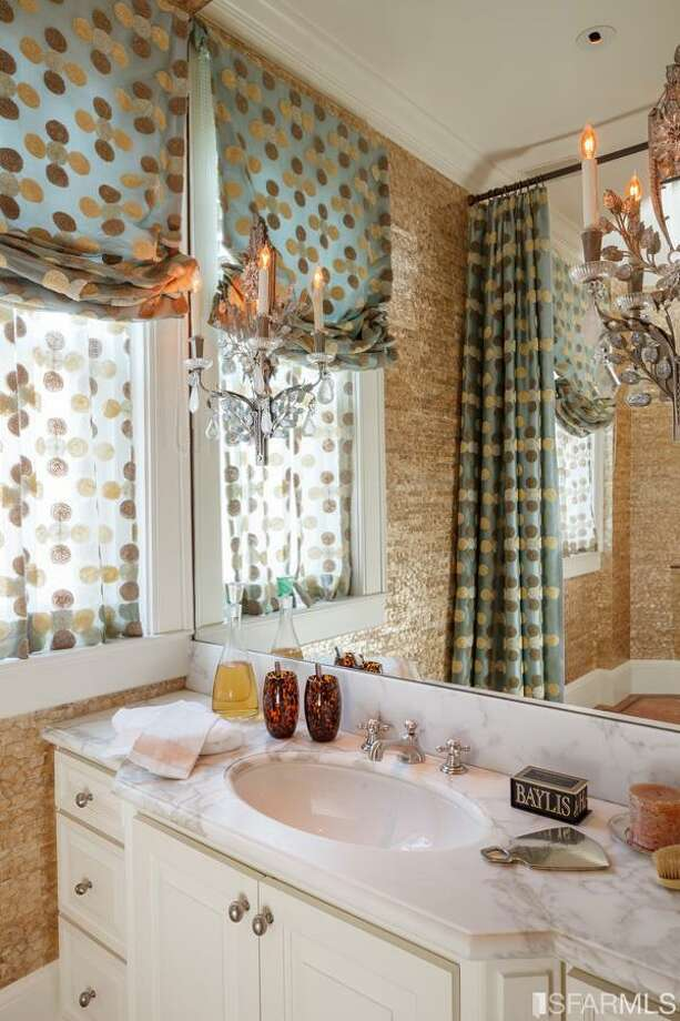 Playful patterns in the bath. All photos via Sotheby's/MLS.