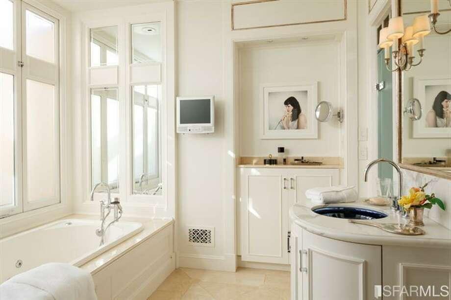 Sparkling white bath. All photos via Sotheby's/MLS.