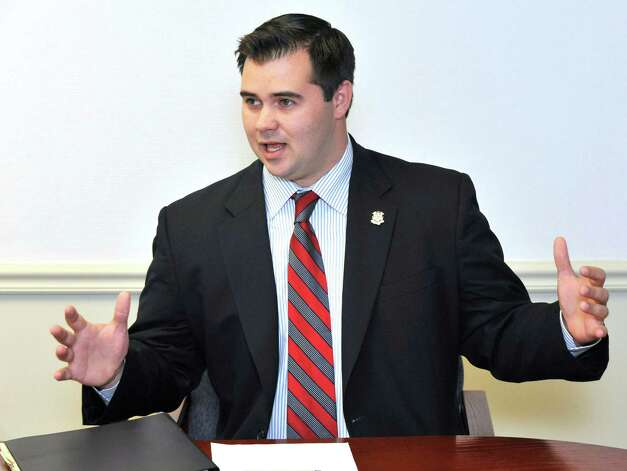 "State Rep. Chris Lyddy, Newtown's former state representative, is a member of Gov. Dannel P. Malloy's Sandy Hook Advisory Commission. He said gun owners should have to give up their weapons to better assure public safety. ""Let's take a stand and give a damn,"" he said. Photo: Michael Duffy, ST / The News-Times"