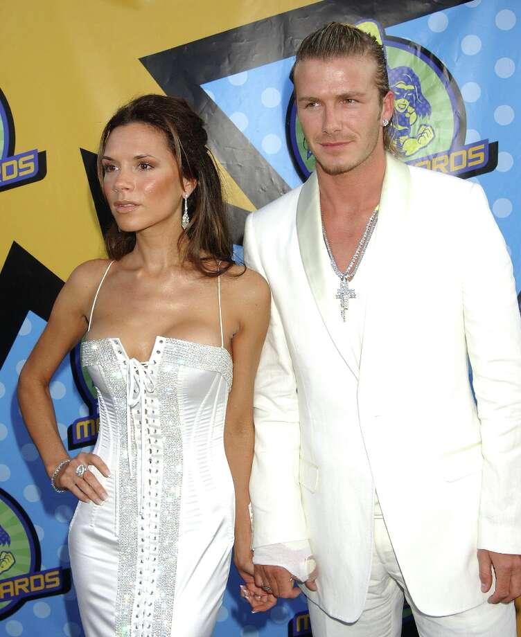 David Beckham & Victoria Beckham during the 2003 MTV Movie Awards at The Shrine Auditorium in Los Angeles, California. Photo: Gregg DeGuire, WireImage / WireImage