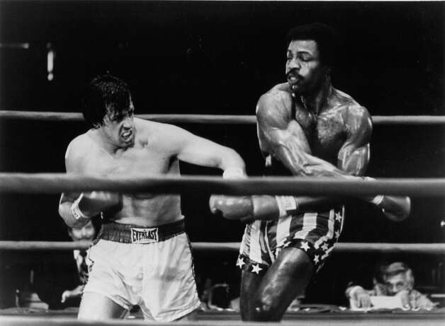 Champion Apollo Creed socks Rocky in 'Rocky.' Photo: Archive Photos, Getty Images / 2012 Getty Images
