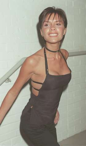 Victoria Beckham, when she was Posh Spice, arrives at the VH1 5th birthday party in London, 1999. Photo: Dave Hogan, Getty Images / 1999 Getty Images