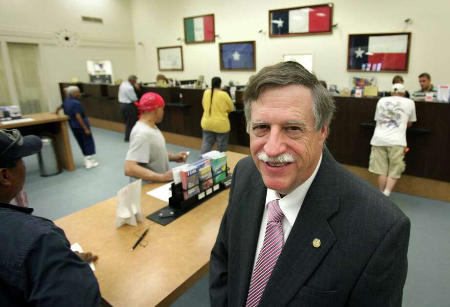 "Hugh B. ""Trip"" Ruckman III, chairman, president and CEO of Karnes County National Bank, in the Karnes City bank, as customers take care of their accounts. Friday, May 25, 2012. Photo: BOB OWEN, San Antonio Express-News / © 2012 San Antonio Express-News"