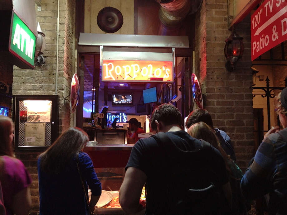 Roppolo's Pizzeria, one of two on Sixth Street, is the popular place to be around 2 a.m.