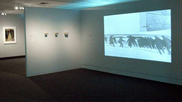 Installation view of gallery including film by Rich Remsberg, Terms of Surrender, archival film, 2008 (Courtesy Albany Airport Art & Culture Program)