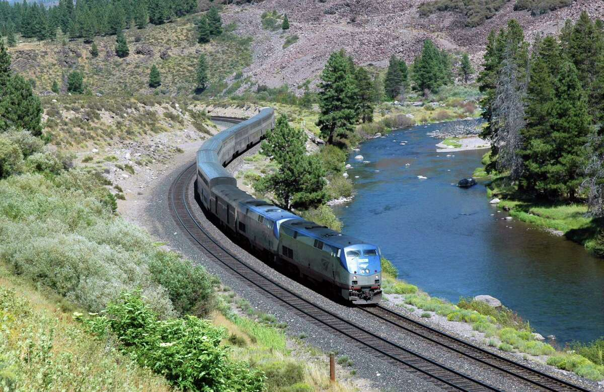 This undated image provided by Amtrak shows the California Zephyr train near Truckee, Calif. The train is one of a number of Amtrak long-distance services that will reduce operations to three days a week starting in October. The California Zephyr starts in Emeryville, Calif., near San Francisco, en route to Reno, Nev., a 236-mile journey that offers beautiful views as well as history. It crosses the Sierra Nevada mountain range and follows the same course as the historic Transcontinental Railroad, a 19th century engineering feat that bolstered the nation?'s western expansion. The Zephyr?'s ultimate destination is Chicago, a 51-hour trip from Emeryville. (AP Photo/Amtrak, Phil Gosney)