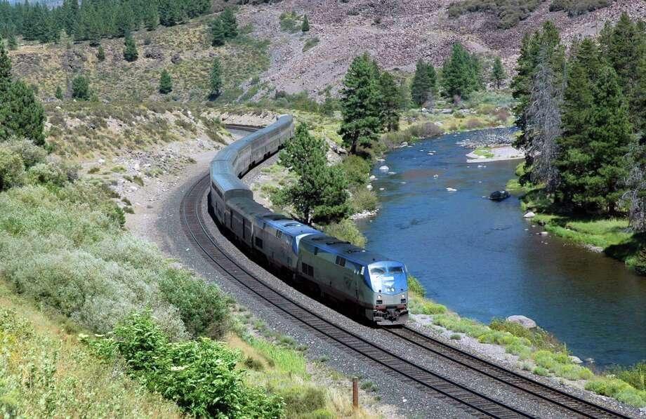 This undated image provided by Amtrak shows the California Zephyr train near Truckee, Calif. The California Zephyr starts in Emeryville, Calif., near San Francisco, en route to Reno, Nev., a 236-mile journey that offers beautiful views as well as history. It crosses the Sierra Nevada mountain range and follows the same course as the historic Transcontinental Railroad, a 19th century engineering feat that bolstered the nation's western expansion. The Zephyr's ultimate destination is Chicago, a 51-hour trip from Emeryville. (AP Photo/Amtrak, Phil Gosney) Photo: Phil Gosney