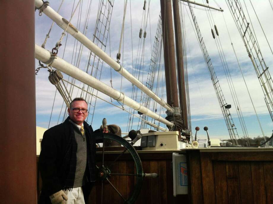 "Chris German, executive director of Connecticut Community Boating in Bridgeport, Conn. standing aboard the ""Mystic,""which is docked in Mystic. German is hoping to raise over $250,000 for a down payment to purchase the $1.8 million boat and keep it in Connecticut. Companies out of state have expressed interest. Photo: Keila Torres Ocasio / Connecticut Post"