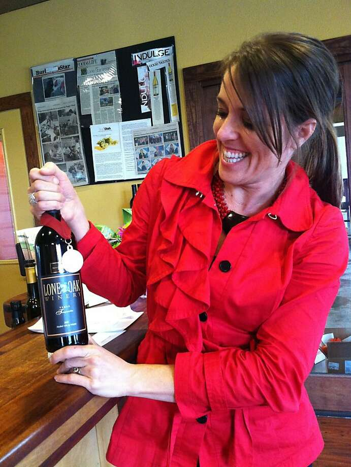 Roxanne Myers of Lost Oak Winery near Fort Worth, Texas, with Tempranillo that took gold at the 2010 San Francisco International Wine Competition. Photo: Barry Shlachter, McClatchy-Tribune News Service