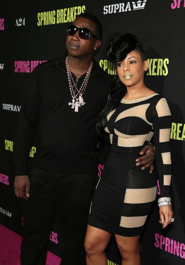 Actor Gucci Mane (L) and guest attend the Spring Breakers premiere at ArcLight Cinemas on March 14, 2013 in Hollywood, California. Photo: Christopher Polk, Getty Images / 2013 Getty Images