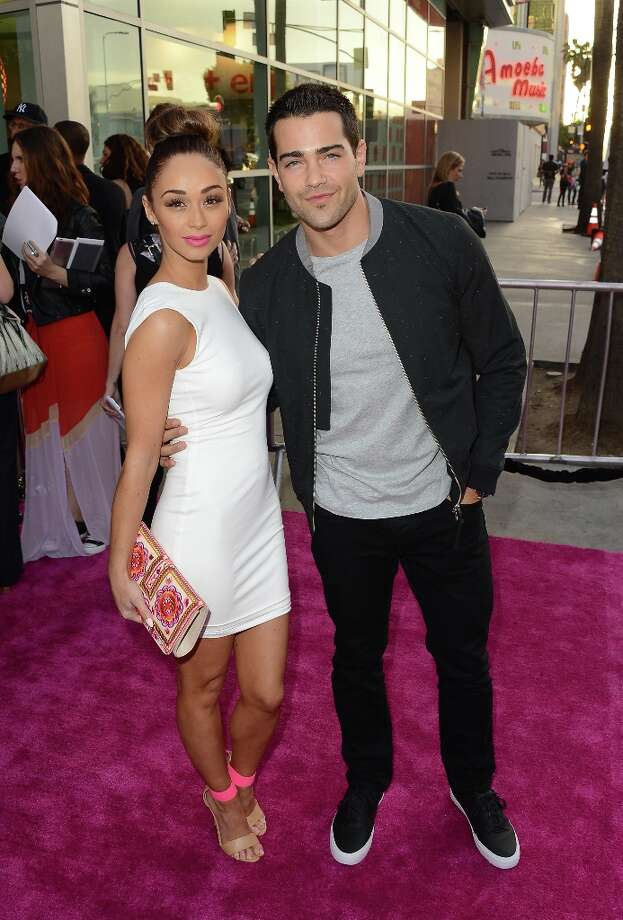 Actors Cara Santana and Jesse Metcalfe attend the 'Spring Breakers' premiere at ArcLight Cinemas on March 14, 2013 in Hollywood, California. Photo: Jason Merritt, Getty Images / 2013 Getty Images