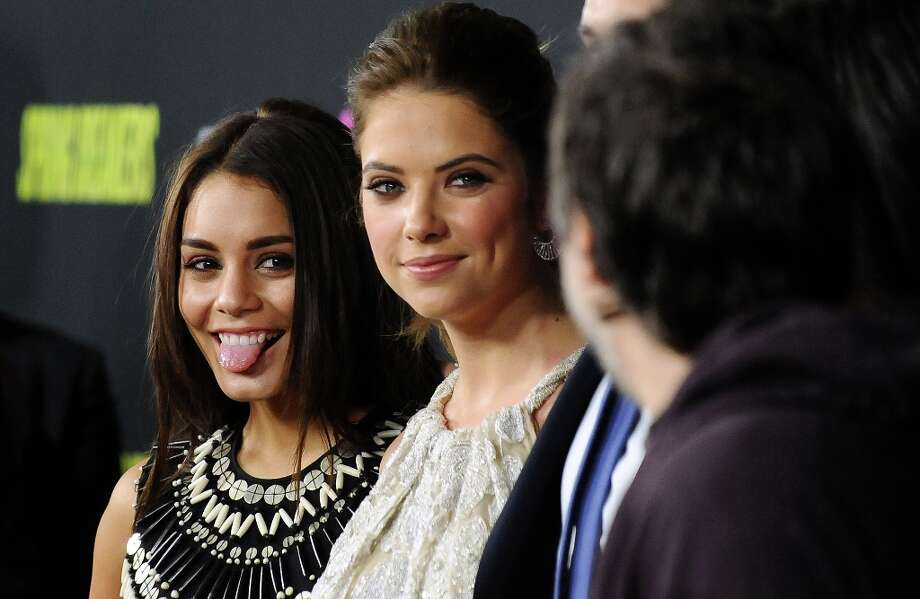 Vanessa Hudgens, left, and Ashley Benson arrive at the LA premiere of Spring Breakers at the ArcLight Hollywood on Thursday, March 14, 2013 in Los Angeles. (Photo by Jordan Strauss/Invision/AP) Photo: Jordan Strauss, Associated Press / Invision