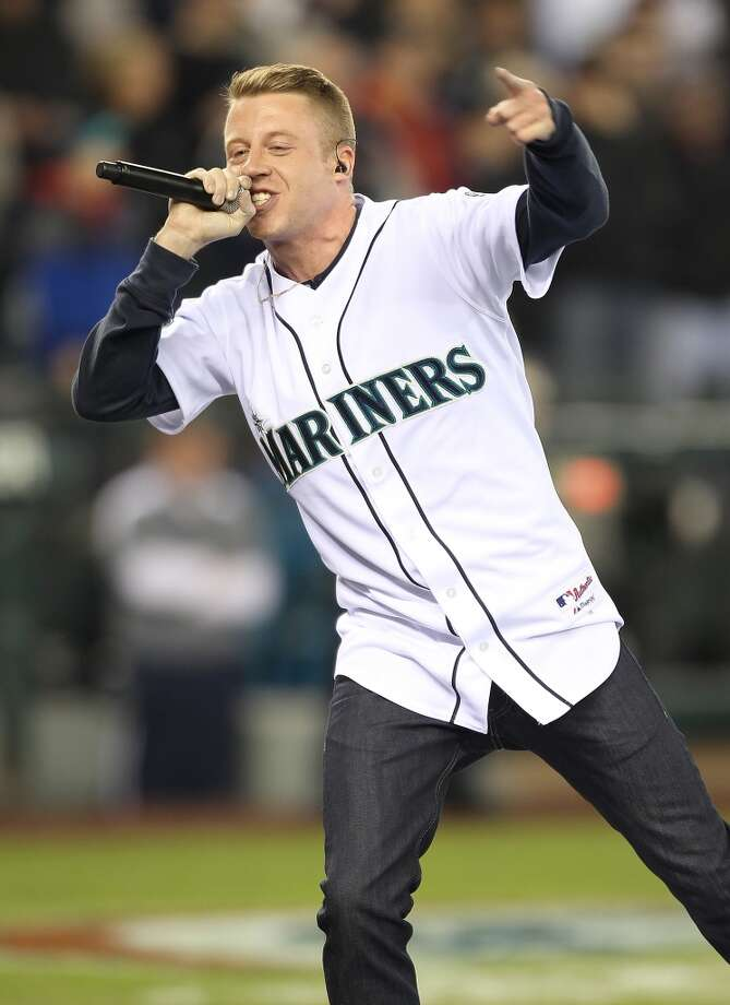 SEATTLE - APRIL 08:  Seattle recording artist Macklemore performs a tribute to Mariners broadcaster Dave Niehaus, who passed away last November, prior to the Mariners' home opener against the Cleveland Indians at Safeco Field on April 8, 2011 in Seattle, Washington. (Photo by Otto Greule Jr/Getty Images)