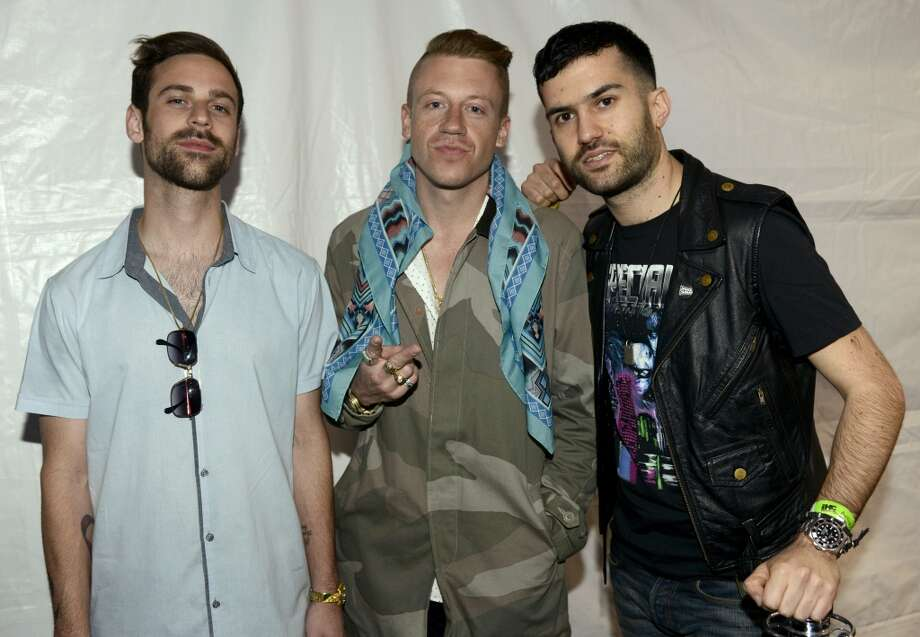AUSTIN, TX - MARCH 14: Macklemore & Ryan Lewis pose with DJ A-Trak at the mtvU Woodie Awards on March 14, 2013 in Austin, Texas. (Photo by Tim Mosenfelder/Getty Images)