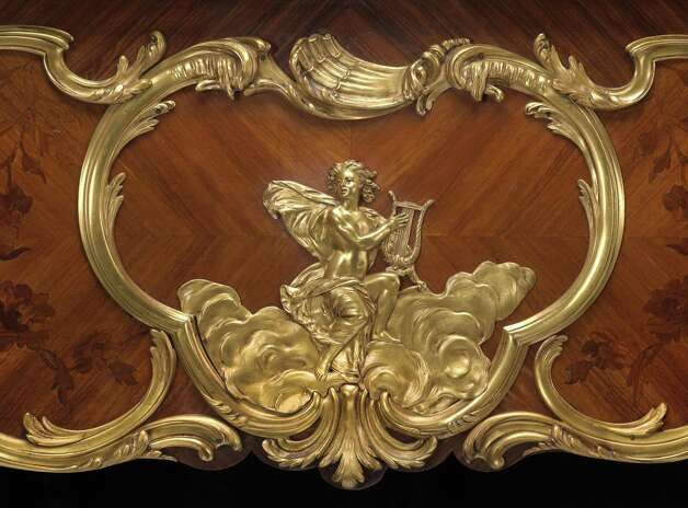 A very fine and historical Louis XV style gilt bronze mounted kingwood and marquetry Steinway art case piano Model L, Serial No. 23914; Case No. C3264 1924-1925 A notable example of exquisite partnering of the finest marquetry inlay and boldly conceived gilt bronze mounts. The harp form top inlaid a quatre faces with a foliate vine sinuously entwining the cross banding and encircling a ribbon tied lute and trumpet trophy, the keyboard flanked by substantial acanthus and rocaille mounts, the case sides with foliate reeded mounts centering ribbon tied musical trophies above a circlet of laurel, and gilt putto musicians strumming lyres perched on billowing clouds, the cabriole legs adorned with acanthus scrolled mounts headed by a floral garland ending in foliate sabots. height 40in (102cm); width 82in (208cm); depth 60in (152cm) Est. $60,000-80,000 Photo: Courtesy Of Bonhams / Courtesy of Bonhams
