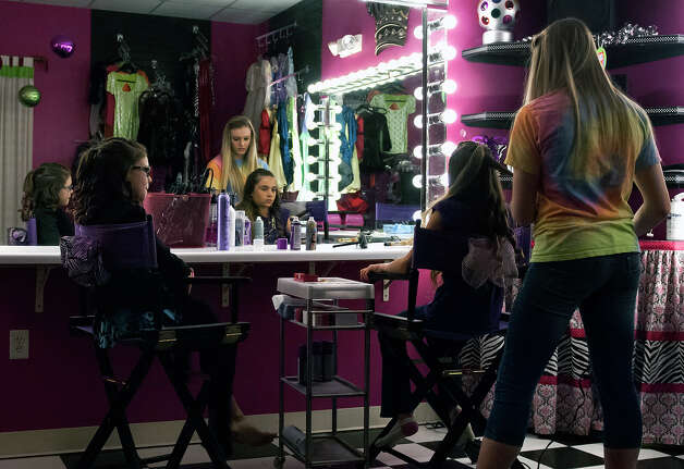 "11 year-old Saide Heiner(left) watches one of her friends get her hair done by stylist Sammy Kingry during her ""glamour girl"" birthday party at Sharkey's Cuts for Kids March 10, 2013. Photo: Steve Faulisi, San Antonio Express-News / ? 2013 San Antonio Express-News"