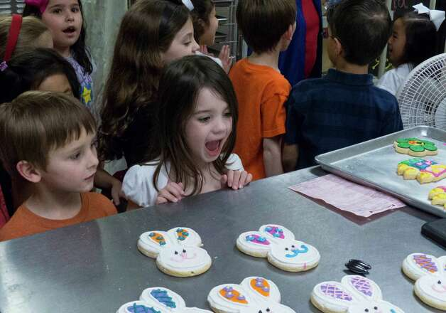 Genna Dieges reacts to the sight of cookies during a birthday party for Liliana Jin Gomez at Cookie Party Time on Saturday, March 9, 2013. Photo: Billy Calzada, San Antonio Express-News / San Antonio Express-News