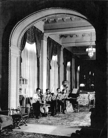 An unidentified quartet performs in the St. Anthony Hotel's Peacock Alley, sometime in the 1940s. The piano pictured, which stood in the hotel for 55 years before being removed, will be sold at auction by Bonhams auction house in San Francisco on March 18, 2013. Photo: Courtesy St. Anthony Hotel