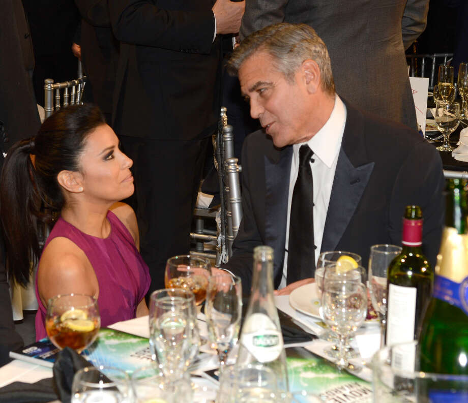 SANTA MONICA, CA - JANUARY 10:  Eva Longoria and George Clooney during the 18th Annual Critics' Choice Movie Awards at The Barker Hanger on January 10, 2013 in Santa Monica, California. Photo: Kevin Mazur, WireImage / 2013 Kevin Mazur