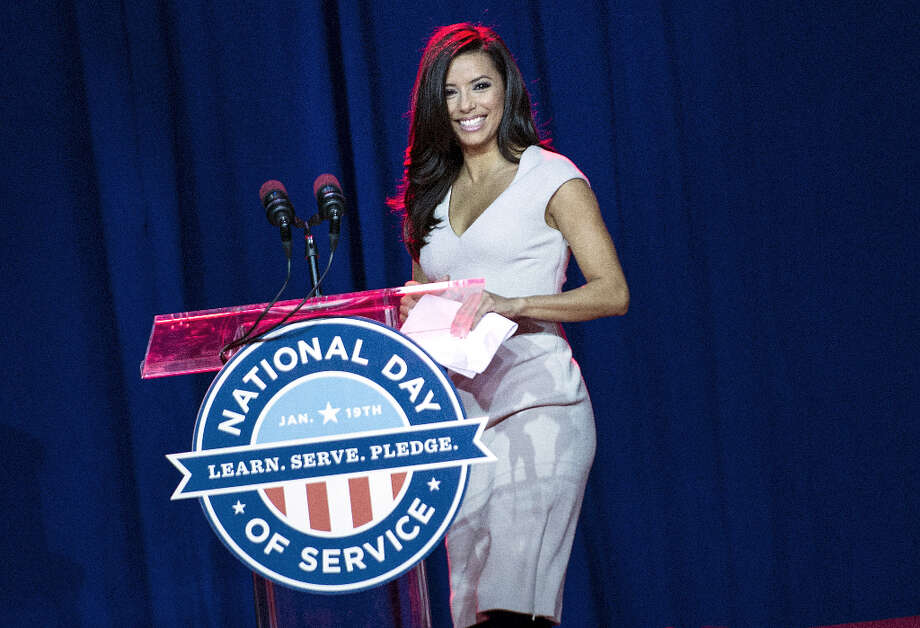 Presidential Inaugural Committee Co-Chair Eva Longoria arrives to speak at a service summit on the National Mall, January 19, 2013 in Washington, DC. As part of the 57th Presidential Inauguration, Americans across the country will participate in service projects in their communities to celebrate the legacy of civil rights leader Dr. Martin Luther King, Jr. The holiday honoring King will be observed on January 21, the day of the second inauguration of US President Barack Obama.  AFP PHOTO/Brendan SMIALOWSKI Photo: BRENDAN SMIALOWSKI, AFP/Getty Images / 2013 AFP