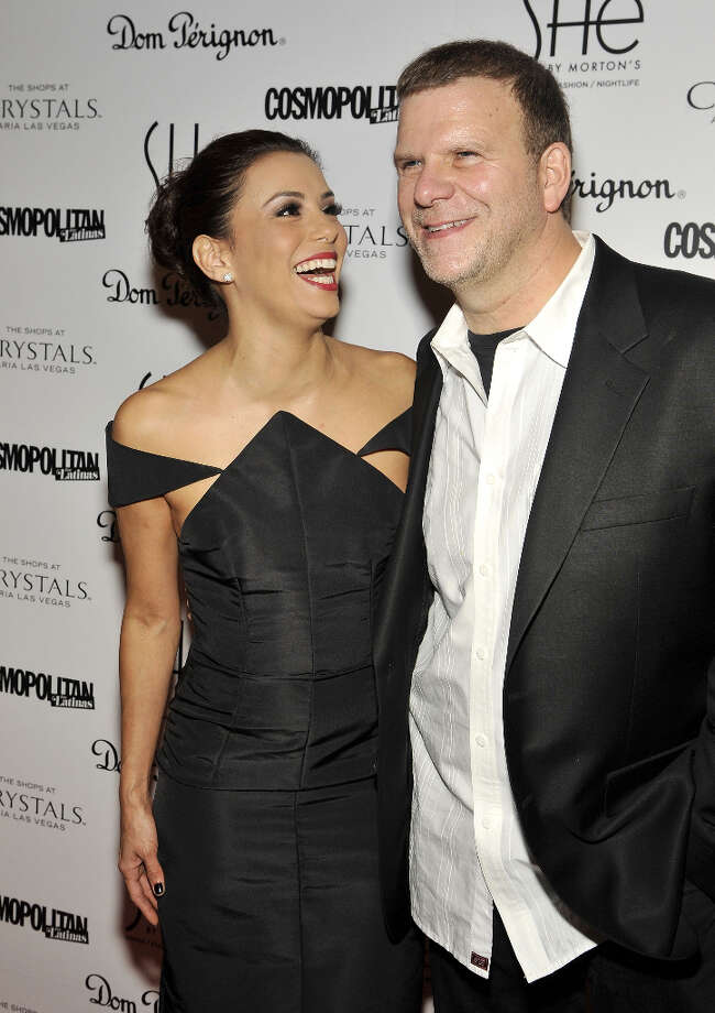 LAS VEGAS, NV - FEBRUARY 02:  Actress Eva Longoria arrives with Tilman Fertitta (R), President and CEO of Landry's Inc., at the grand opening of SHe by Morton's at Crystals at CityCenter on February 2, 2013 in Las Vegas, Nevada. Photo: Jeff R. Bottari, Getty Images / 2013 Jeff R. Bottari