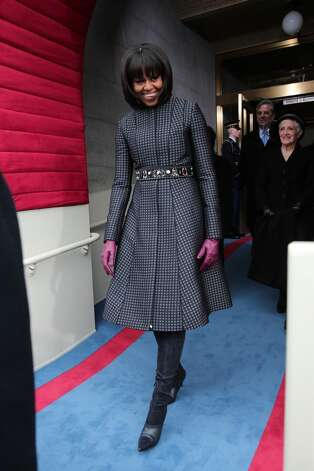 The first lady in an intricate Thom Browne coat at the presidential inauguration January 21, 2013.