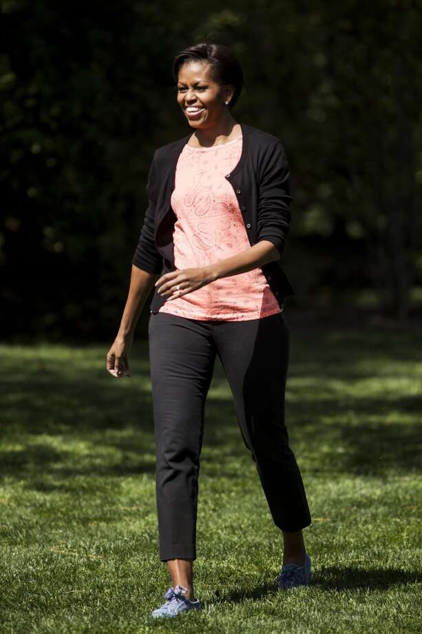 The first lady looking casual as she welcomes school children from across the country to join her for the fourth annual White House Kitchen Garden spring planting.