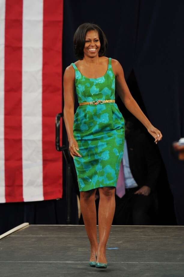 Showing off her toned arms with a sleeveless dress during a campaign event at Barbara Goleman Senior High School in 2012.