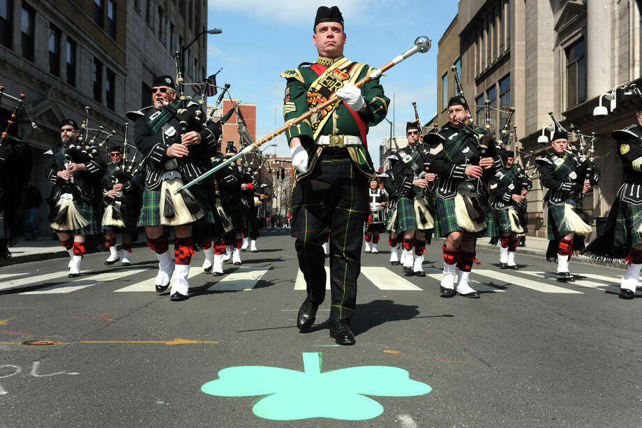 Terrance McGovern leads the Manchester Regional Police & Fire Pipe Band down Main Street during the annual Greater Bridgeport St. Patrick's Day Parade, in Bridgeport, Conn., March 15th, 2013. Photo: Ned Gerard / Connecticut Post