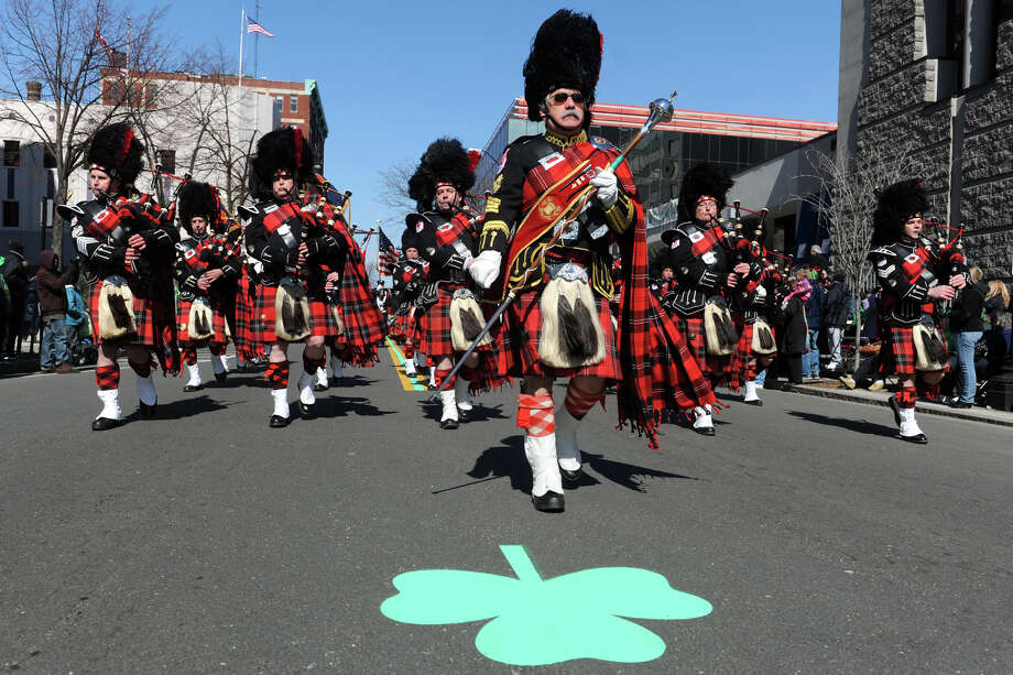 The Connecticut Firefighrters fife and drum corps march down Main Street during the annual Greater Bridgeport St. Patrick's Day Parade, in Bridgeport, Conn., March 15th, 2013. Photo: Ned Gerard / Connecticut Post