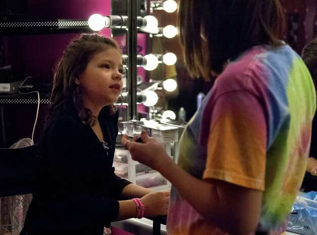 "11 year-old Saide Heiner (left) tells stylist Ashta Ermis (right) what kind of make-up she wants applied during her ""glamour girl"" birthday party at Sharkey's Cuts for Kids March 10, 2013 Photo: Steve Faulisi, San Antonio Express-News / ? 2013 San Antonio Express-News"