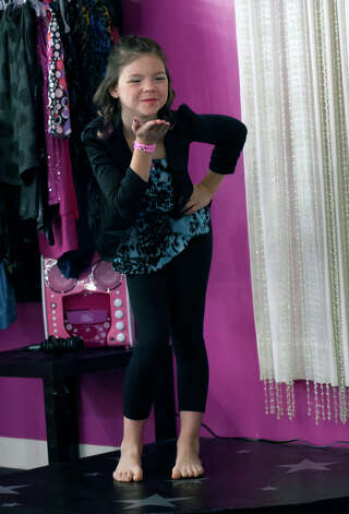 "11 year-old Saide Heiner blows a kiss as she is introduced during a fashion show at her ""glamour girl"" birthday party at Sharkey's Cuts for Kids March 10, 2013 Photo: Steve Faulisi, San Antonio Express-News / ? 2013 San Antonio Express-News"